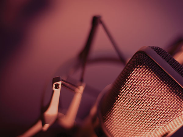voiceover visual of a microphone with purple orange lighting